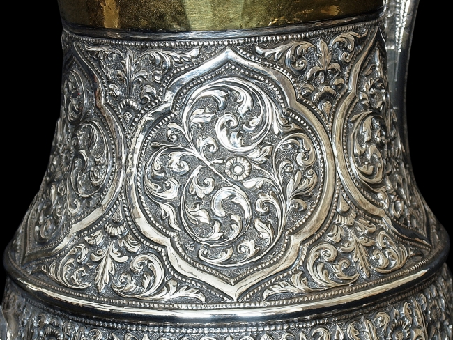 The cartouches are unusual in Cutch silverware, and reminiscent of a more Islamic style of decoration
